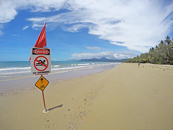 No swimming allowed in Cairns Four mile beach Australia