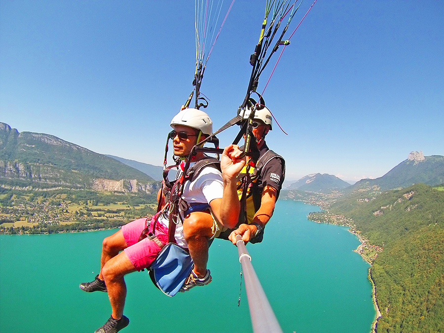 Anthony is paragliding above Annecy Lake
