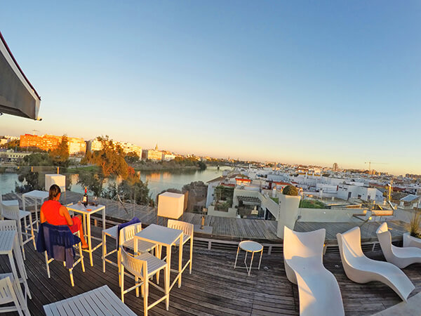 Enjoying the sunset with a glass of wine at Level 5th Rooftop bar, Hotel Ribera de Triana