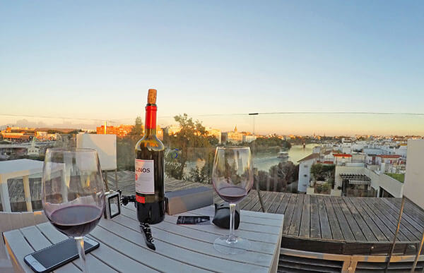 Enjoying the sunset with a glass of wine at the terrace of Hotel Ribera de Triana, Seville