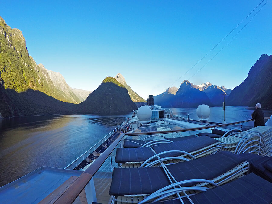 enjoying the sunrise of Milford Sound from Celebrity Solstice top deck